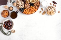 Traditional Iftar Food. Traditional Muslim Iftar Food, copy space. Ramadan kareem with premium dates,nuts, dried fruits, coffee and milk on white table stock photo
