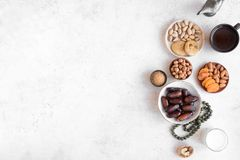 Traditional Iftar Food. Traditional Muslim Iftar Food, copy space. Ramadan kareem with premium dates, nuts, dried fruits and coffee. Ramadan iftar food concept royalty free stock photography