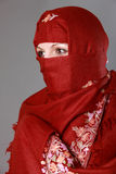 Traditional Muslim woman. Portrait of traditional Muslim woman wearing red Hijab Stock Images