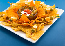 Traditional Nachos with Olives and Jalapenos Royalty Free Stock Photos