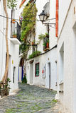 Traditional narrow street in Cadaques Royalty Free Stock Images