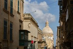 Traditional narrow street and church in Valletta in Malta. Traditional narrow street and church in Valletta, capital of Malta Stock Image