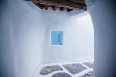 Traditional narrow street in Mykonos with blue doors and white walls. Narrow street in Mykonos with blue doors and white walls royalty free stock images