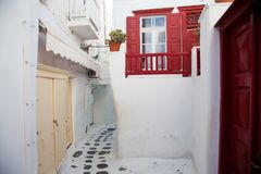 Traditional narrow street in Mykonos with blue doors and white walls. Narrow street in Mykonos with blue doors and white walls royalty free stock photos