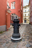 Traditional narrow street in old town of Riga city, Latvia Stock Photography