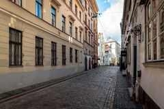 Traditional narrow street in old town of Riga city, Latvia Royalty Free Stock Photo