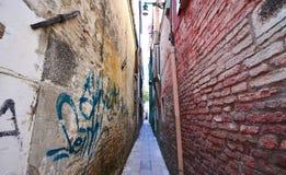 Traditional narrow street in Venice Stock Photo