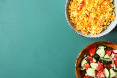 Traditional National Mexican Tomato Rice Stewed Pilaf with Hot Chili Peppers Garlic in Turquoise Bowl. Fresh Cucumber Onion Salsa. Salad in Wooden Dish. Green royalty free stock image