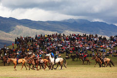 Traditional national nomad horse riding. VALLEY ASSY, KAZAKHSTAN - August 12 : A traditional national nomad long-distance horse riding competition Bayga in Stock Image
