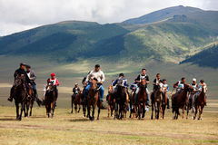 Traditional national nomad horse riding. VALLEY ASSY, KAZAKHSTAN - August 12 : A traditional national nomad long-distance horse riding competition Bayga in Royalty Free Stock Photo