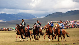 Traditional national nomad horse riding. VALLEY ASSY, KAZAKHSTAN - August 12 : A traditional national nomad long-distance horse riding competition Bayga in Royalty Free Stock Photos