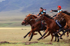 Traditional national nomad horse riding Royalty Free Stock Image