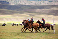 Traditional national nomad horse riding. VALLEY ASSY, KAZAKHSTAN - August 12 : A traditional national nomad long-distance horse riding competition Bayga in Stock Images