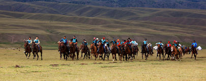 Traditional national nomad horse riding. VALLEY ASSY, KAZAKHSTAN - August 12 : A traditional national nomad long-distance horse riding competition Bayga in Royalty Free Stock Images