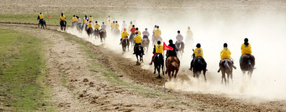 Traditional national nomad horse riding. AKCHI, KAZAKHSTAN - MARCH 22 : A traditional national nomad long-distance horse riding competition Bayga in action on Stock Photography