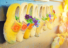 The traditional national wooden shoes Klomp like  flowerpots wit Royalty Free Stock Photos