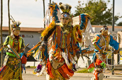 Traditional Native Amercian Dancers in Parade. Traditional native amercian dancer in the Parada Del Sol (called world's largest horse drawn parade) held in Royalty Free Stock Image