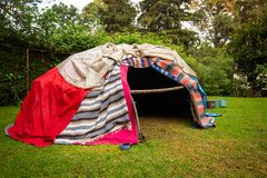 Traditional native sweat lodge with hot stones royalty free stock photo