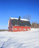Traditional New England Red Barn in the winter Royalty Free Stock Images