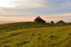Traditional nomad's tent or yurta with lorry truck and SUV car Royalty Free Stock Images