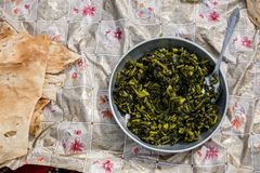 Traditional nomads dish in Zagros mountains. stock photo