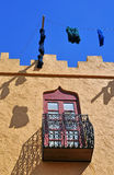 Traditional North African house. A traditional north African house with windows, balcony and hanging decorations on a bright sunny day Royalty Free Stock Photo