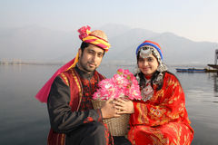 Traditional North Indian Couple. In Pathani (Kashmir) dress exchanging a flower basket Stock Image