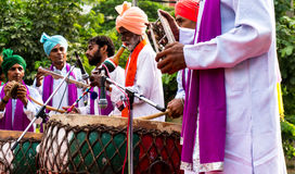 Traditional north indian musicians. Delhi, India; 10th Aug 2014 - Traditional north indian musicians playing local instruments. The colorful dresses are Royalty Free Stock Photography