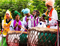 Traditional north indian musicians. Delhi, India; 10th Aug 2014 - Traditional north indian musicians playing local instruments. The colorful dresses are Royalty Free Stock Image