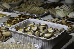Traditional northern english party buffet. Quiche, crisps, scotch eggs, sandwiches, sausage rolls stock image