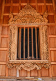 Traditional northern Thai style church window Stock Photography