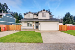 Traditional northwest home with driveway. Stock Images