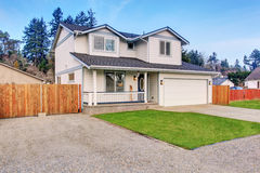 Traditional northwest home with driveway. Royalty Free Stock Image