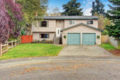 Traditional northwest house with garage. Royalty Free Stock Images