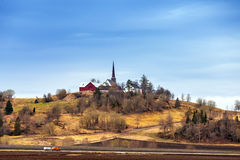Traditional Norwegian Church in small village on the hill Royalty Free Stock Photo