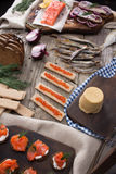 Traditional Norwegian cuisine - Brunost and fish Stock Images