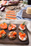 Traditional Norwegian cuisine - Brunost and fish Stock Photo