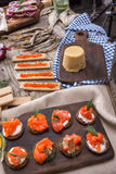 Traditional Norwegian cuisine - Brunost and fish Stock Photos
