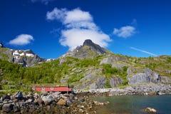 Norwegian hut in fjord Stock Images