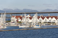 Traditional norwegian harbor village with houses and yatchs. Sta Royalty Free Stock Photo