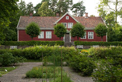 Traditional Norwegian house. The old brick house with tiled roof with the garden in front Stock Photography