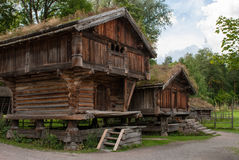Traditional Norwegian house. The old wooden house with dirt roof on the blue sky background Royalty Free Stock Photo