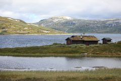 Traditional norwegian house in rugged landscape Stock Image