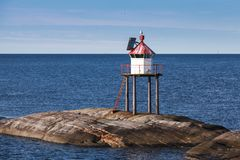 Traditional Norwegian lighthouse tower, red light royalty free stock image