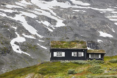 Traditional norwegian mountain landscape with black wooden house Stock Image
