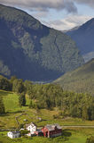 Traditional norwegian mountain landscape with old wooden houses. Royalty Free Stock Photos