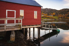 Traditional Norwegian red wooden barn. Stands on the sea coast. Snillfjord, Sor-Trondelag region, Vingvagen fishing village Stock Photos
