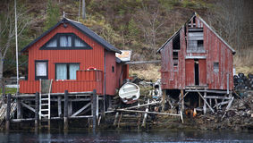 Traditional Norwegian red wooden boat barns Royalty Free Stock Photos