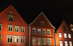 Norwegian red wooden houses at night Stock Photos