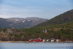 Traditional Norwegian small fishing village landscape Stock Photos